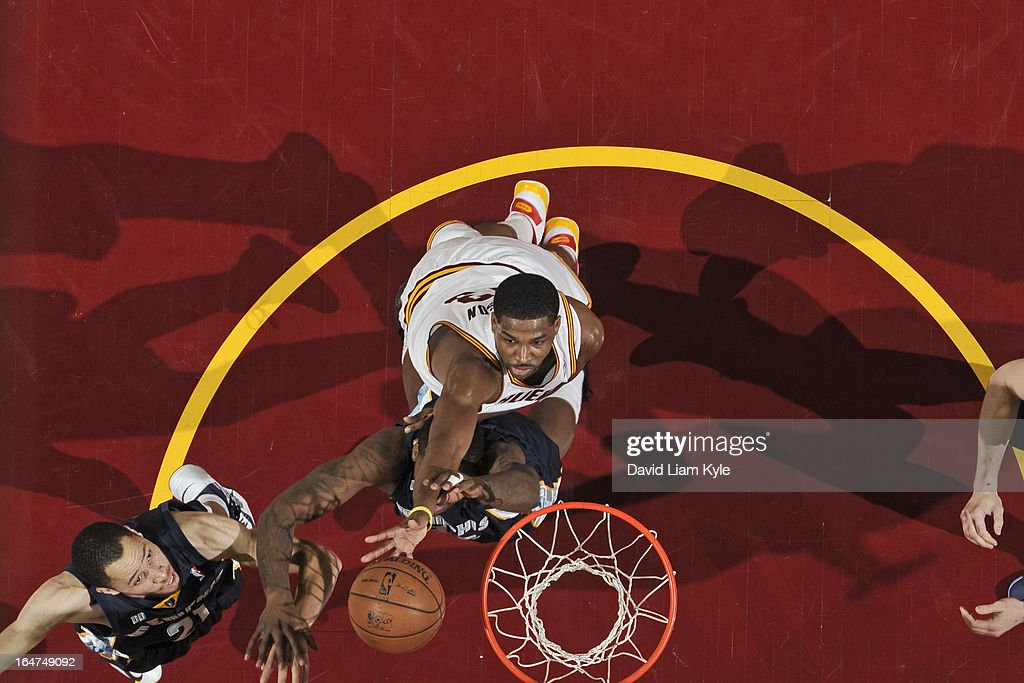 <a gi-track='captionPersonalityLinkClicked' href=/galleries/search?phrase=Tristan+Thompson&family=editorial&specificpeople=5799092 ng-click='$event.stopPropagation()'>Tristan Thompson</a> #13 of the Cleveland Cavaliers grabs a rebound against the Memphis Grizzlies at The Quicken Loans Arena on March 8, 2013 in Cleveland, Ohio.