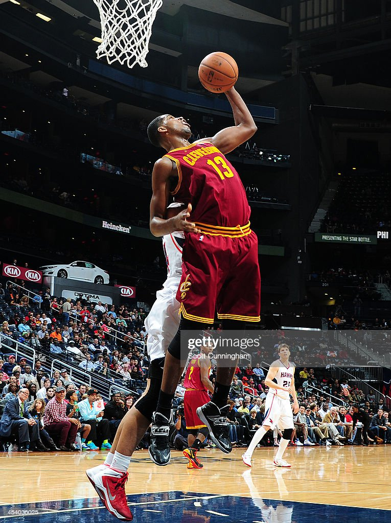 Tristan Thompson #13 of the Cleveland Cavaliers grabs a rebound against the Atlanta Hawks on December 6, 2013 at Philips Arena in Atlanta, Georgia.