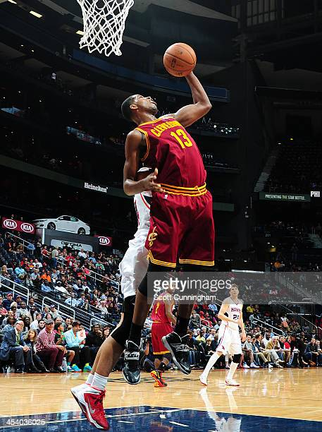 Tristan Thompson of the Cleveland Cavaliers grabs a rebound against the Atlanta Hawks on December 6 2013 at Philips Arena in Atlanta Georgia NOTE TO...