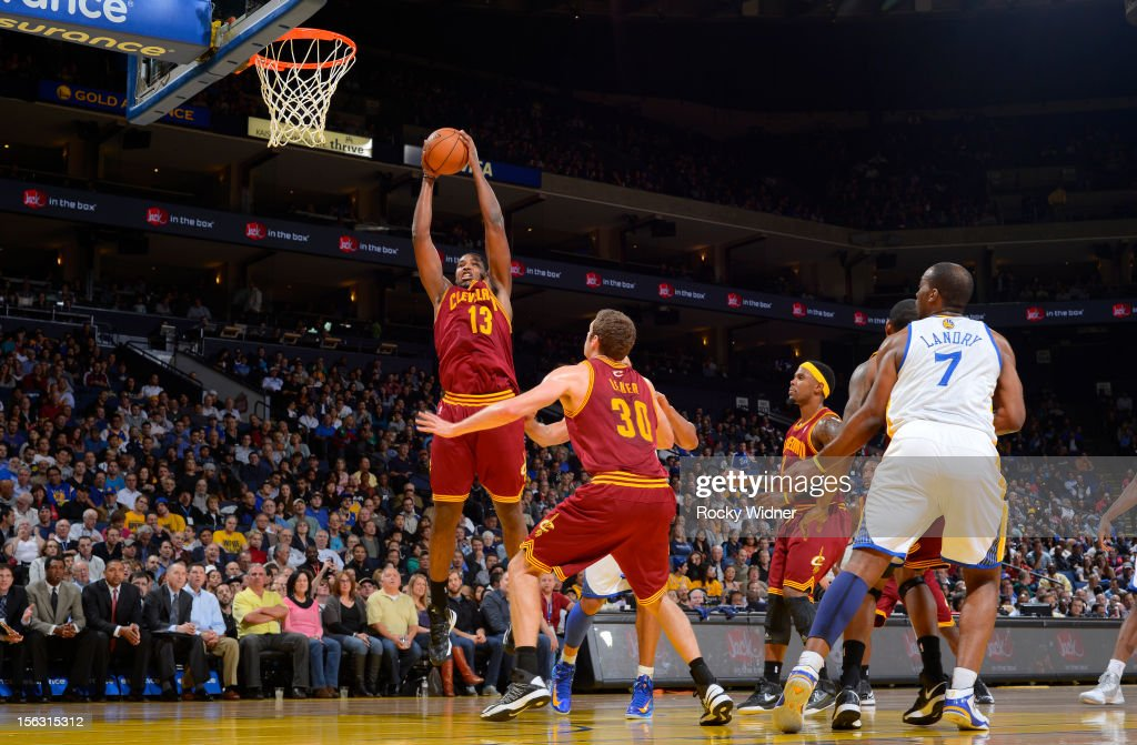 <a gi-track='captionPersonalityLinkClicked' href=/galleries/search?phrase=Tristan+Thompson&family=editorial&specificpeople=5799092 ng-click='$event.stopPropagation()'>Tristan Thompson</a> #13 of the Cleveland Cavaliers grabs the rebound against the Golden State Warriors on November 7, 2012 at Oracle Arena in Oakland, California.