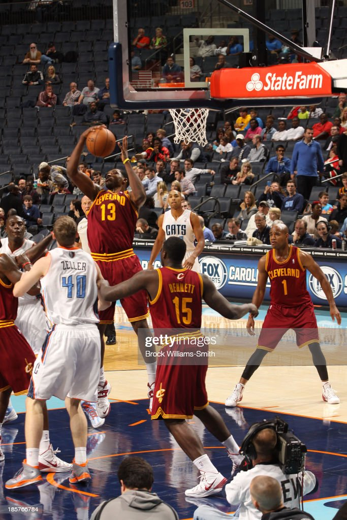 <a gi-track='captionPersonalityLinkClicked' href=/galleries/search?phrase=Tristan+Thompson&family=editorial&specificpeople=5799092 ng-click='$event.stopPropagation()'>Tristan Thompson</a> #13 of the Cleveland Cavaliers grabs the rebound against <a gi-track='captionPersonalityLinkClicked' href=/galleries/search?phrase=Cody+Zeller&family=editorial&specificpeople=7621233 ng-click='$event.stopPropagation()'>Cody Zeller</a> #40 of the Charlotte Bobcats during the game at the Time Warner Cable Arena on October 24, 2013 in Charlotte, North Carolina.