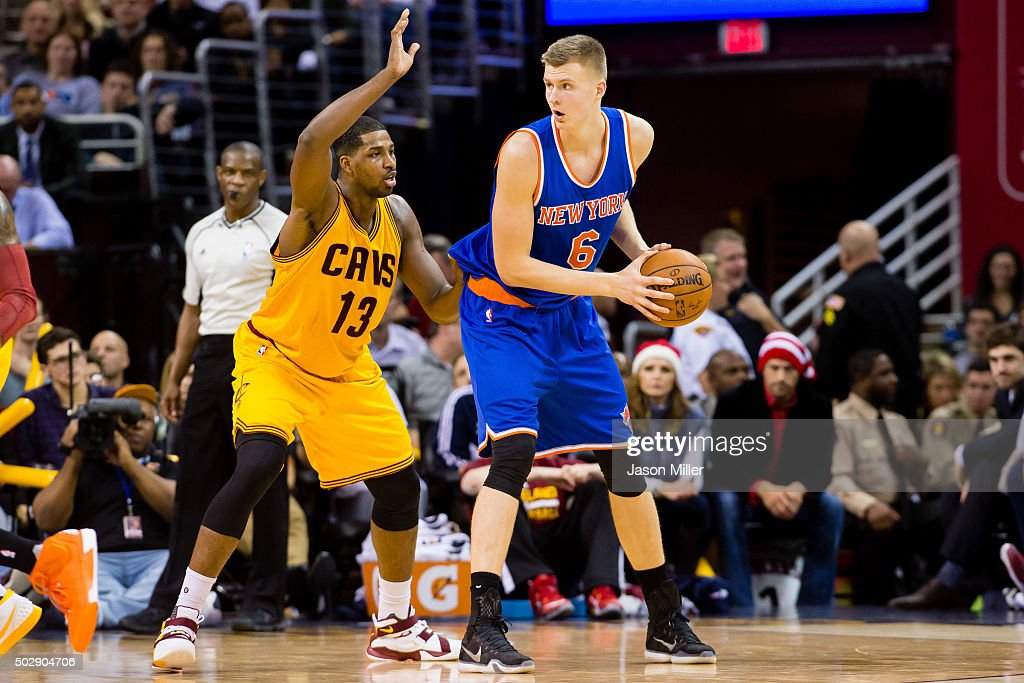 Tristan Thompson of the Cleveland Cavaliers guards Kristaps Porzingis of the New York Knicks during the second half at Quicken Loans Arena on...