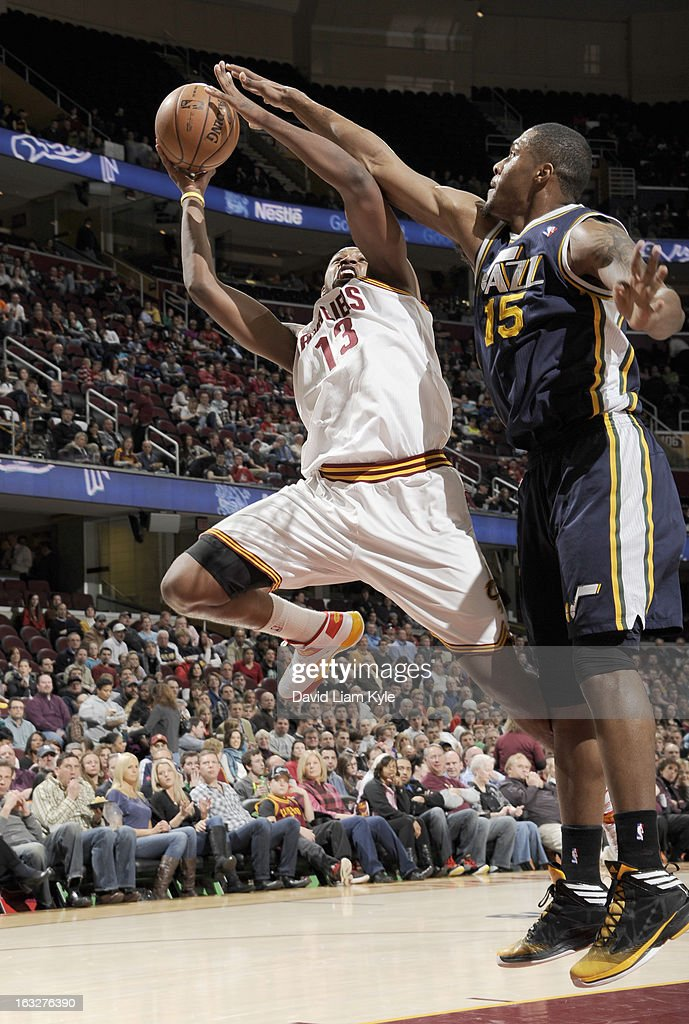 Tristan Thompson #13 of the Cleveland Cavaliers handles the ball against Derrick Favors #15 of the Utah Jazz during the game between the Cleveland Cavaliers and the Utah Jazz at The Quicken Loans Arena on March 6, 2013 in Cleveland, Ohio.