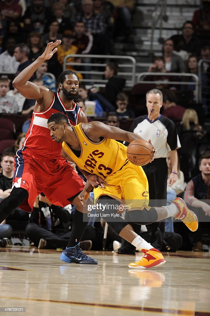 <a gi-track='captionPersonalityLinkClicked' href=/galleries/search?phrase=Tristan+Thompson&family=editorial&specificpeople=5799092 ng-click='$event.stopPropagation()'>Tristan Thompson</a> #13 of the Cleveland Cavaliers handles the ball against the Washington Wizards at The Quicken Loans Arena on February 23, 2014 in Cleveland, Ohio.