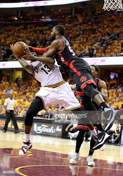 Tristan Thompson of the Cleveland Cavaliers handles the ball in the third quarter against Patrick Patterson of the Toronto Raptors in game five of...