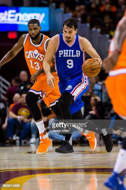 Tristan Thompson of the Cleveland Cavaliers puts pressure on Dario Saric of the Philadelphia 76ers during the first half at Quicken Loans Arena on...