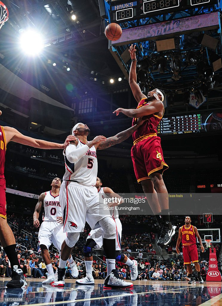 Tristan Thompson #13 of the Cleveland Cavaliers puts up a shot over Josh Smith #5 of the Atlanta Hawks at Philips Arena on November 30, 2012 in Atlanta, Georgia.