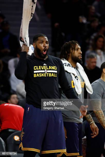 Tristan Thompson of the Cleveland Cavaliers reacts to a dunk by teammate LeBron James while playing the Detroit Pistons at the Palace of Auburn Hills...