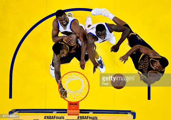Tristan Thompson of the Cleveland Cavaliers shoots against Draymond Green of the Golden State Warriors in the second half during Game Five of the...