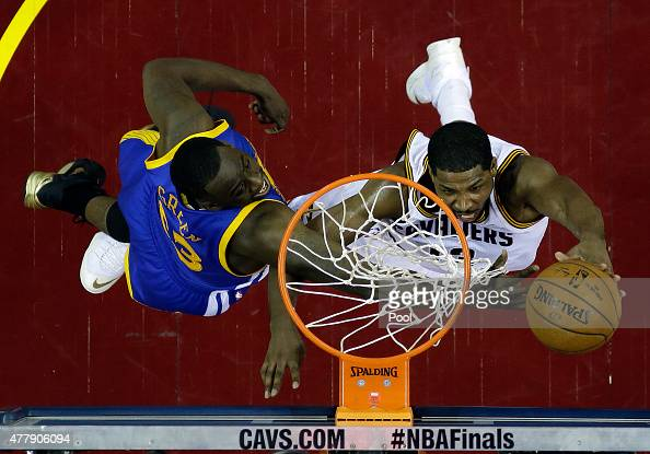 Tristan Thompson of the Cleveland Cavaliers shoots against Draymond Green of the Golden State Warriors during Game Six of the 2015 NBA Finals at...