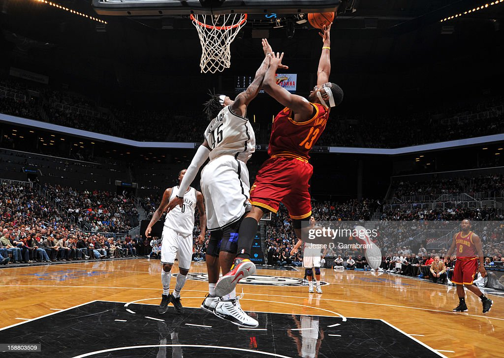 Tristan Thompson #13 of the Cleveland Cavaliers shoots against Gerald Wallace #45 of the Brooklyn Nets during the game at the Barclays Center on December 29, 2012 in Brooklyn, New York.