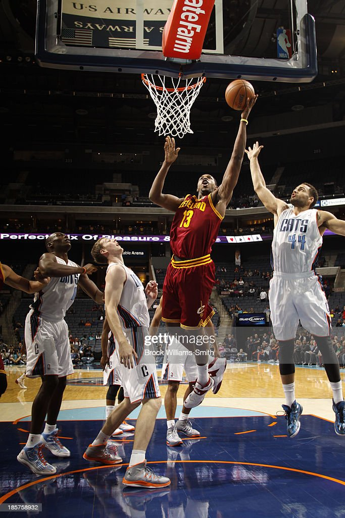 <a gi-track='captionPersonalityLinkClicked' href=/galleries/search?phrase=Tristan+Thompson&family=editorial&specificpeople=5799092 ng-click='$event.stopPropagation()'>Tristan Thompson</a> #13 of the Cleveland Cavaliers shoots against Jeffery Taylor #14 of the Charlotte Bobcats during the game at the Time Warner Cable Arena on October 24, 2013 in Charlotte, North Carolina.