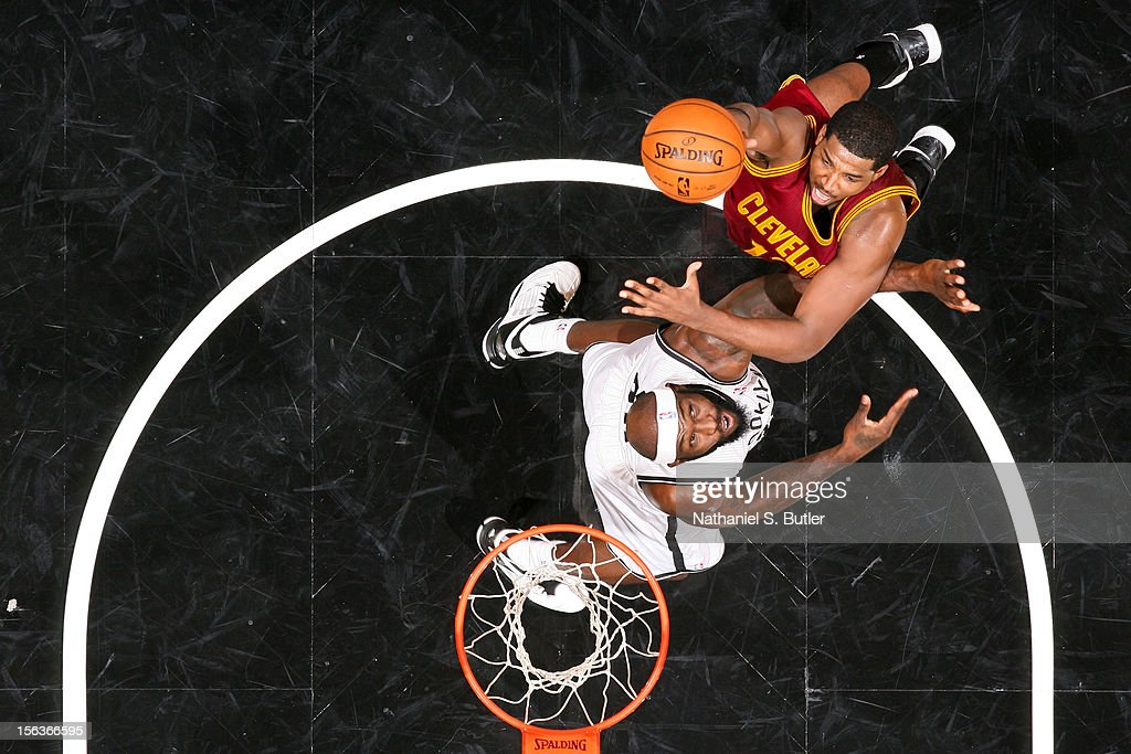 <a gi-track='captionPersonalityLinkClicked' href=/galleries/search?phrase=Tristan+Thompson&family=editorial&specificpeople=5799092 ng-click='$event.stopPropagation()'>Tristan Thompson</a> #13 of the Cleveland Cavaliers shoots against <a gi-track='captionPersonalityLinkClicked' href=/galleries/search?phrase=Reggie+Evans&family=editorial&specificpeople=202254 ng-click='$event.stopPropagation()'>Reggie Evans</a> #30 of the Brooklyn Nets on November 13, 2012 at the Barclays Center in the Brooklyn Borough of New York City.