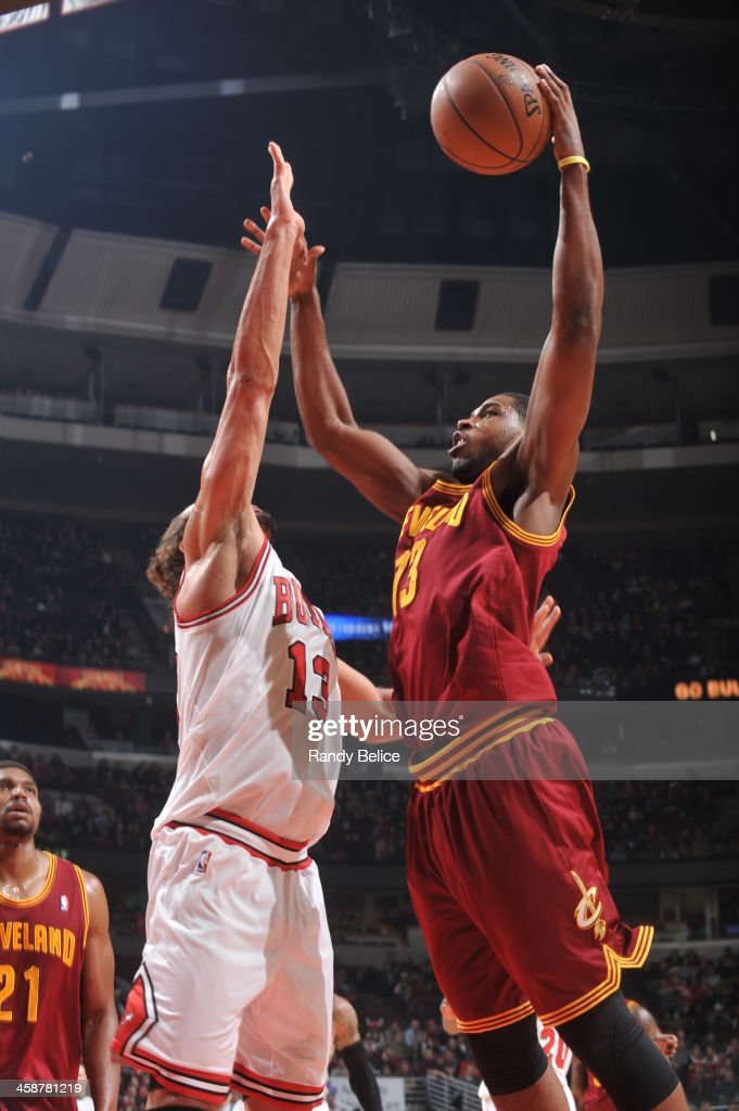 <a gi-track='captionPersonalityLinkClicked' href=/galleries/search?phrase=Tristan+Thompson&family=editorial&specificpeople=5799092 ng-click='$event.stopPropagation()'>Tristan Thompson</a> #13 of the Cleveland Cavaliers shoots against the Chicago Bulls on December 21, 2013 at the United Center in Chicago, Illinois.