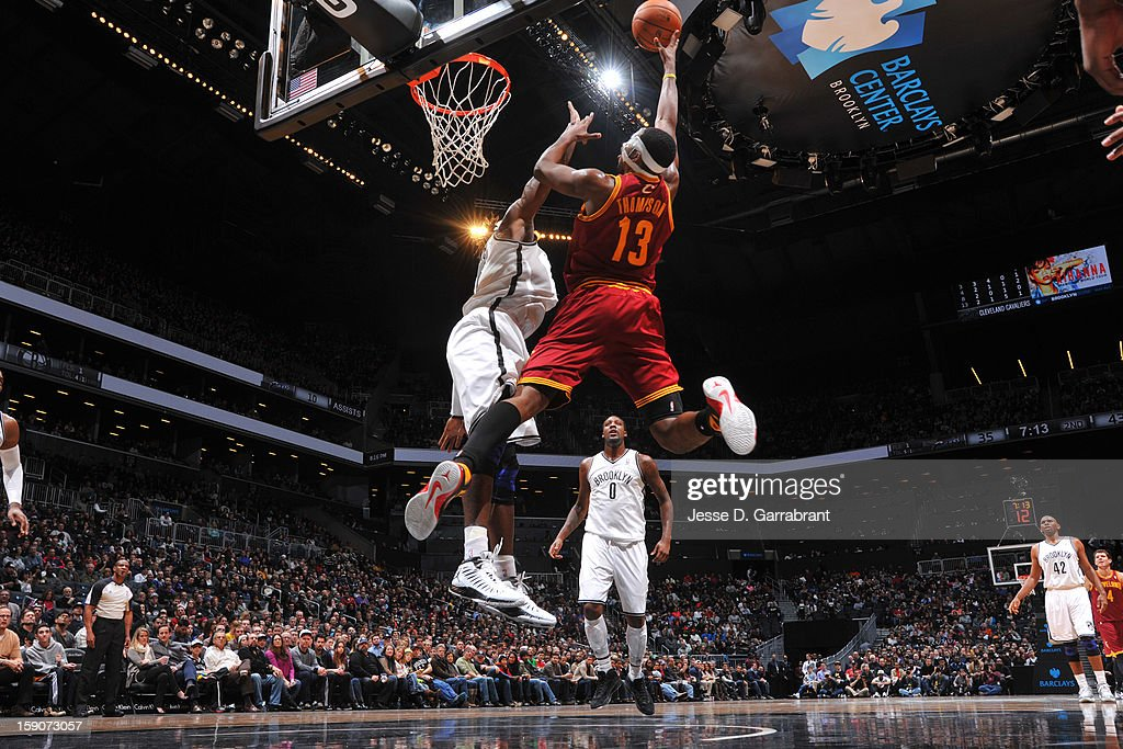 <a gi-track='captionPersonalityLinkClicked' href=/galleries/search?phrase=Tristan+Thompson&family=editorial&specificpeople=5799092 ng-click='$event.stopPropagation()'>Tristan Thompson</a> #13 of the Cleveland Cavaliers shoots against the Brooklyn Nets at the Barclays Center on December 29, 2012 in Brooklyn, New York.
