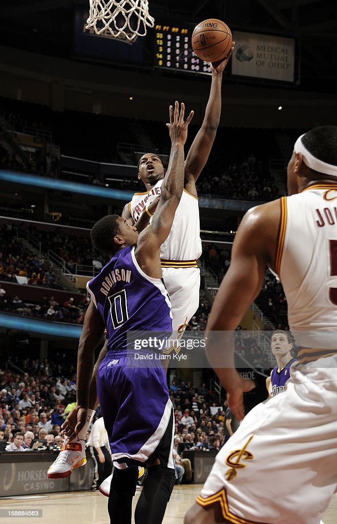 Tristan Thompson #13 of the Cleveland Cavaliers shoots against Thomas Robinson #0 of the Sacramento Kings at The Quicken Loans Arena on January 2, 2013 in Cleveland, Ohio.