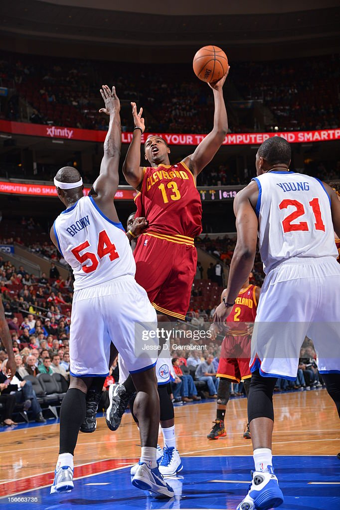 Tristan Thompson #13 of the Cleveland Cavaliers shoots the ball against Kwame Brown #54 of the Philadelphia 76ers at the Wells Fargo Center on November 18, 2012 in Philadelphia, Pennsylvania.