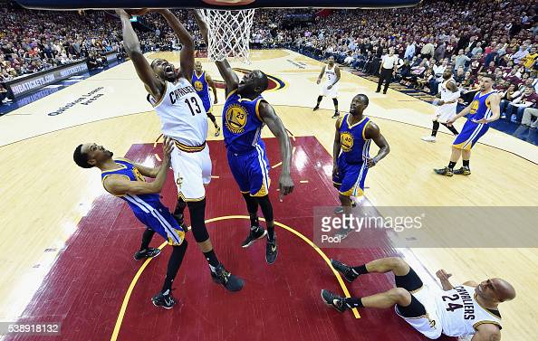 Tristan Thompson of the Cleveland Cavaliers shoots the ball against Shaun Livingston of the Golden State Warriors and Draymond Green in Game 3 of the...