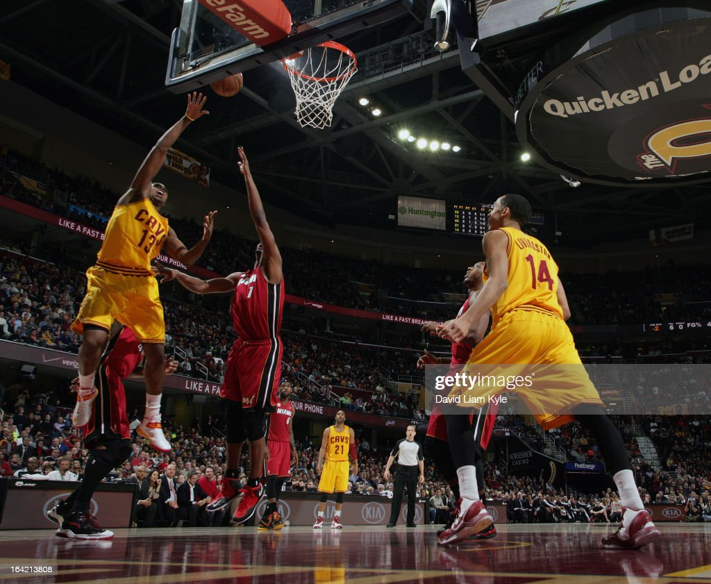 Tristan Thompson #13 of the Cleveland Cavaliers tosses up the shot against Chris Bosh #1 of the Miami Heat at The Quicken Loans Arena on March 20, 2013 in Cleveland, Ohio.