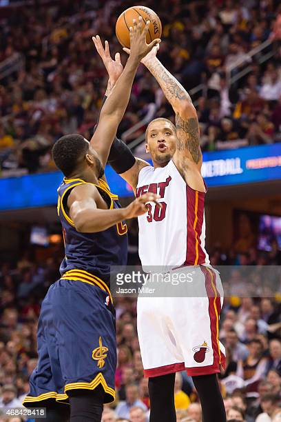 Tristan Thompson of the Cleveland Cavaliers tries to block Michael Beasley of the Miami Heat during the first half at Quicken Loans Arena on April 2...