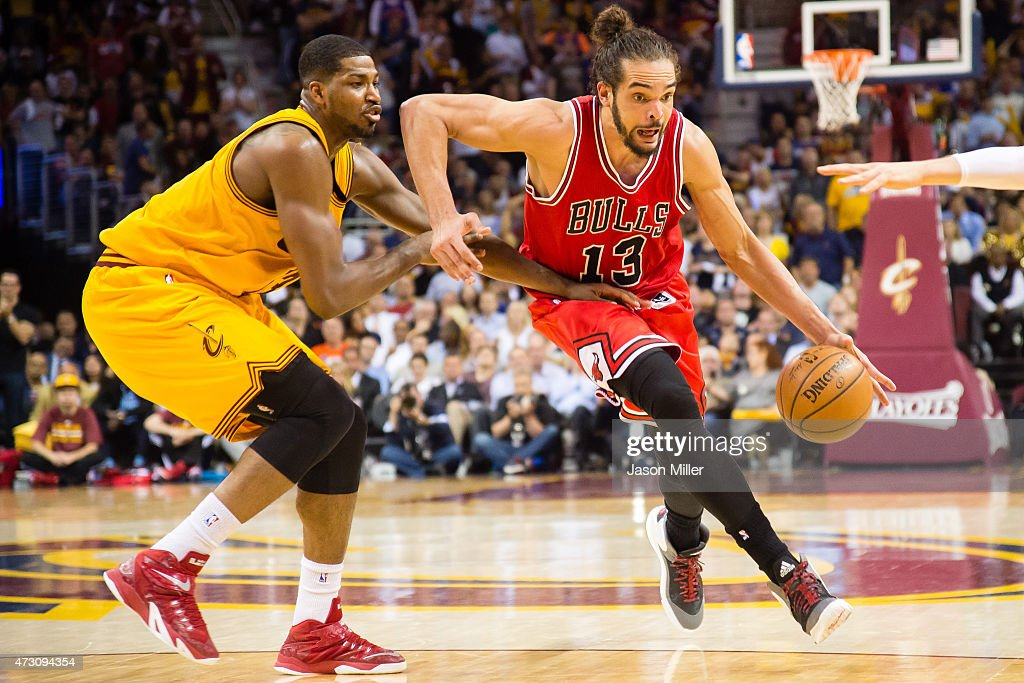 Tristan Thompson of the Cleveland Cavaliers tries to guard Joakim Noah of the Chicago Bulls in the second half during Game Five in the Eastern...