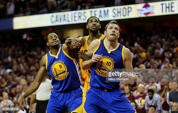 Tristan Thompson of the Cleveland Cavaliers vies for position with Andre Iguodala and David Lee of the Golden State Warriors during Game Three of the...