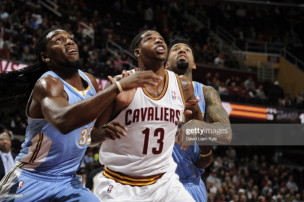 <a gi-track='captionPersonalityLinkClicked' href=/galleries/search?phrase=Tristan+Thompson&family=editorial&specificpeople=5799092 ng-click='$event.stopPropagation()'>Tristan Thompson</a> #13 of the Cleveland Cavaliers waits for the rebound against the Denver Nuggets at The Quicken Loans Arena on December 4, 2013 in Cleveland, Ohio.