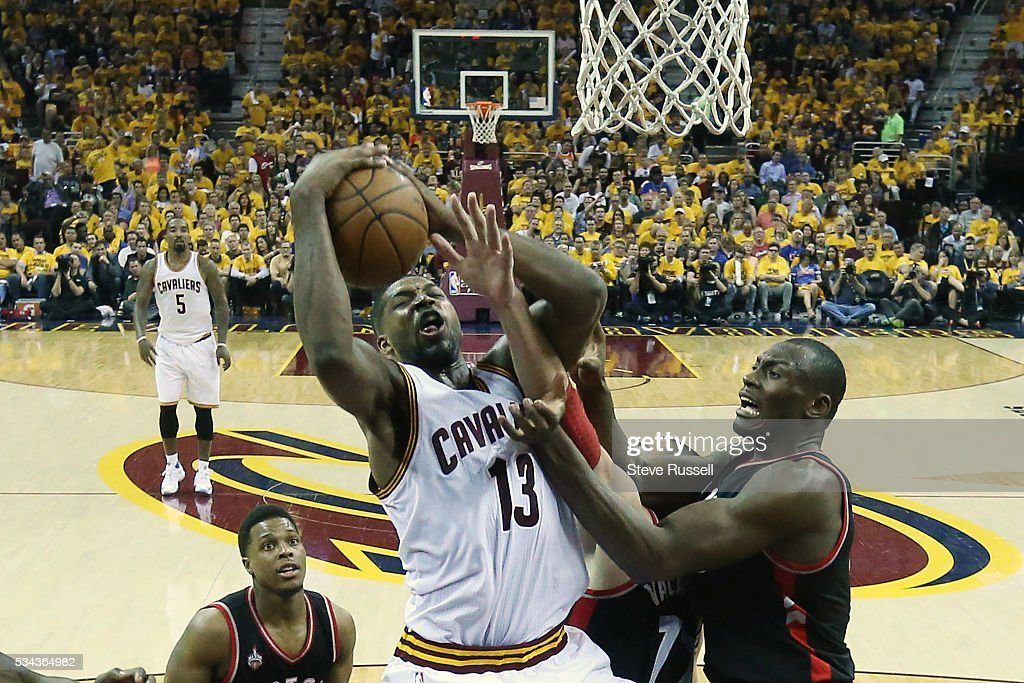 Tristan Thompson pulls down a rebound in front of Bismack Biyombo as the Toronto Raptors lose the Cleveland Cavaliers in game 5 of the NBA Conference Finals at Quicken Loans Arena in Cleveland. May 25, 2016.