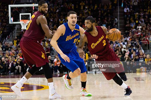 Tristan Thompson sets a pick as Kyrie Irving of the Cleveland Cavaliers drives around Klay Thompson of the Golden State Warriors during the second...