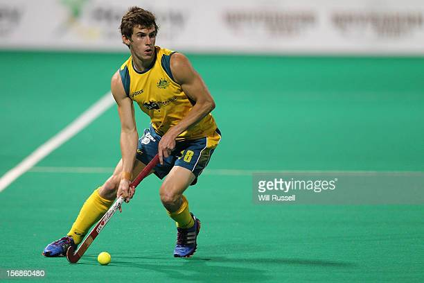 Tristan White looks to hit the ball during the Australia v India game during day two of the 2012 International Super Series at Perth Hockey Stadium...
