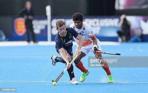 Tristan White of Australia and Kothajit Khadangbam during the FIH Mens Hero Hockey Champions Trophy match between Australia and India at Queen...