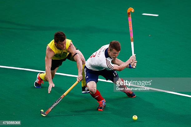 Tristan White of Australia attempts to stop Sam Ward of Great Britain shooting on goal during the Fintro Hockey World League SemiFinal match between...