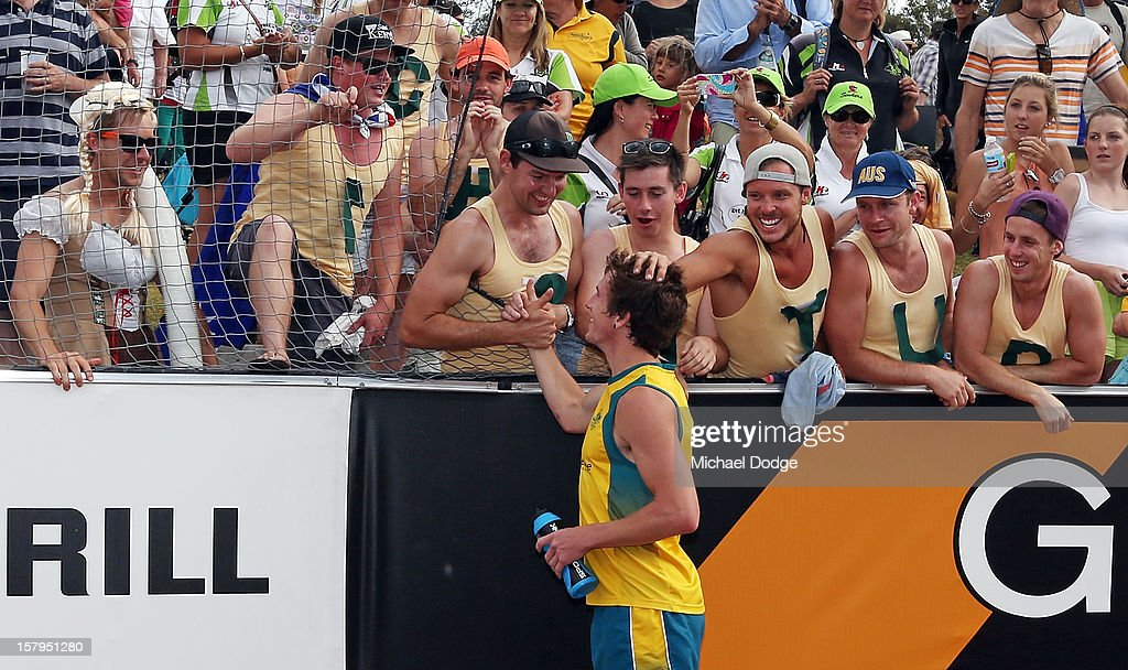 Tristan White of Australia celebrates the win with fans after the match between Australia and India during day five of the 2012 Champions Trophy at the State Netball and Hockey Centre on December 8, 2012 in Melbourne, Australia.
