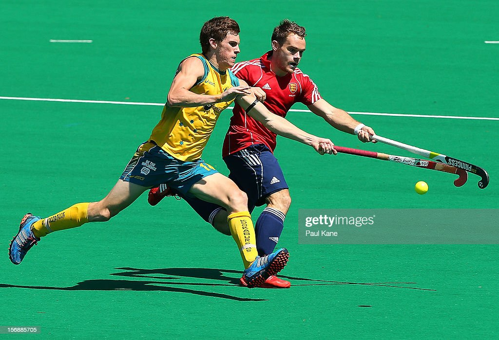 Tristan White of the Kookaburras and Barry Middleton of England contest for the ball in the mens Australia Kookaburras v England game during day three of the 2012 International Super Series at Perth Hockey Stadium on November 24, 2012 in Perth, Australia.