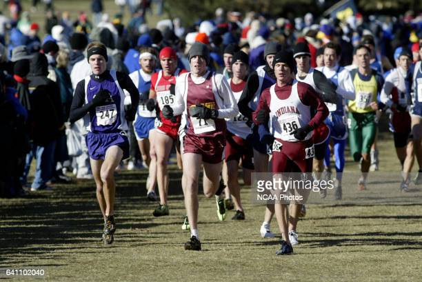 Tristen Perlberg of Central Michigan University and Chris Powers of Indiana University lead the second wave during the Division I Men's Cross Country...