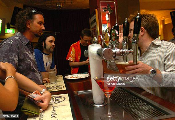 Trivia host Kevin Curley in red hawaiian shirt takes time out for an ale with friends at The Excelsior Glebe 24 January 2006 SHD NEWS Picture by...