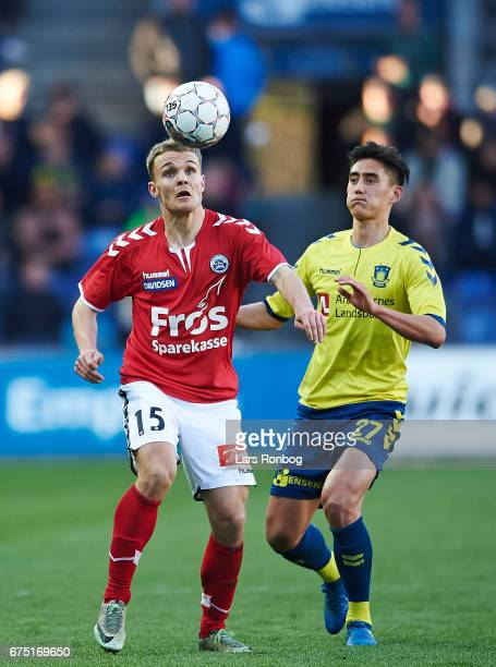Troels Klove of Sonderjyske and Svenn Crone of Brondby IF compete for the ball during the Danish Alka Superliga match between Brondby IF and...