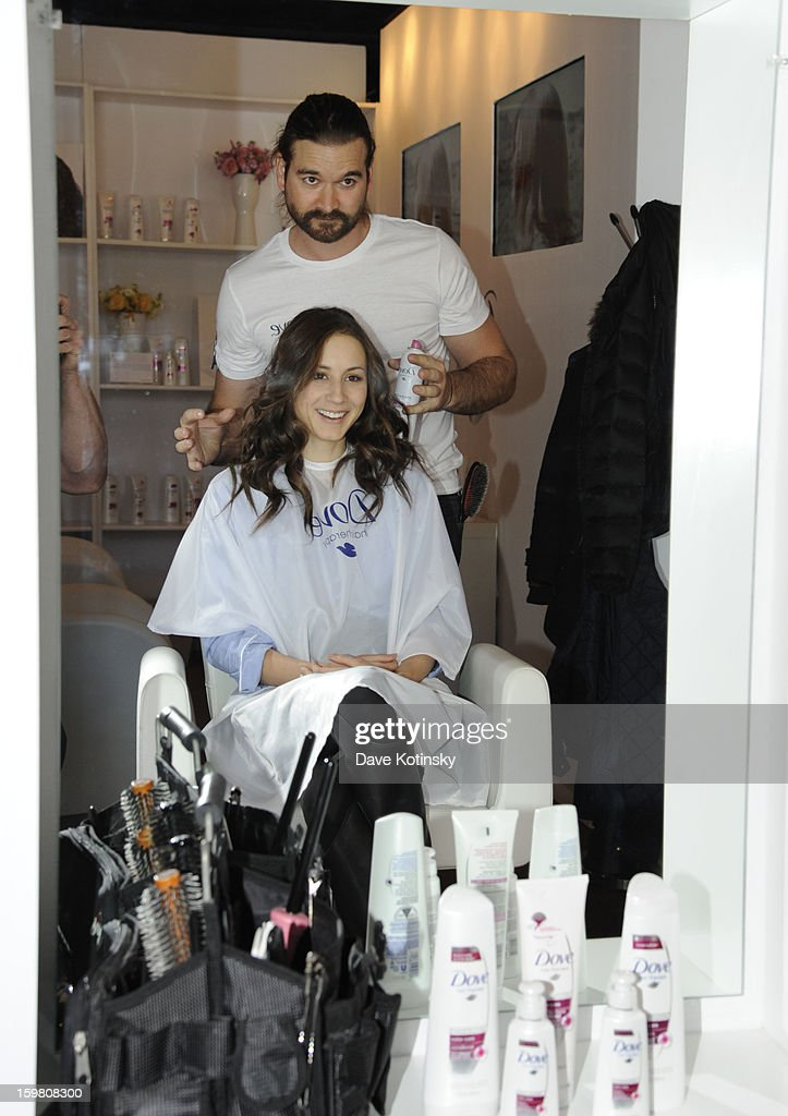 Troian Bellisario gets tips for keeping her hair vibrant from celebrity stylist Matt Fugate at the Dove Color Care Salon on January 20, 2013 in Park City, Utah.