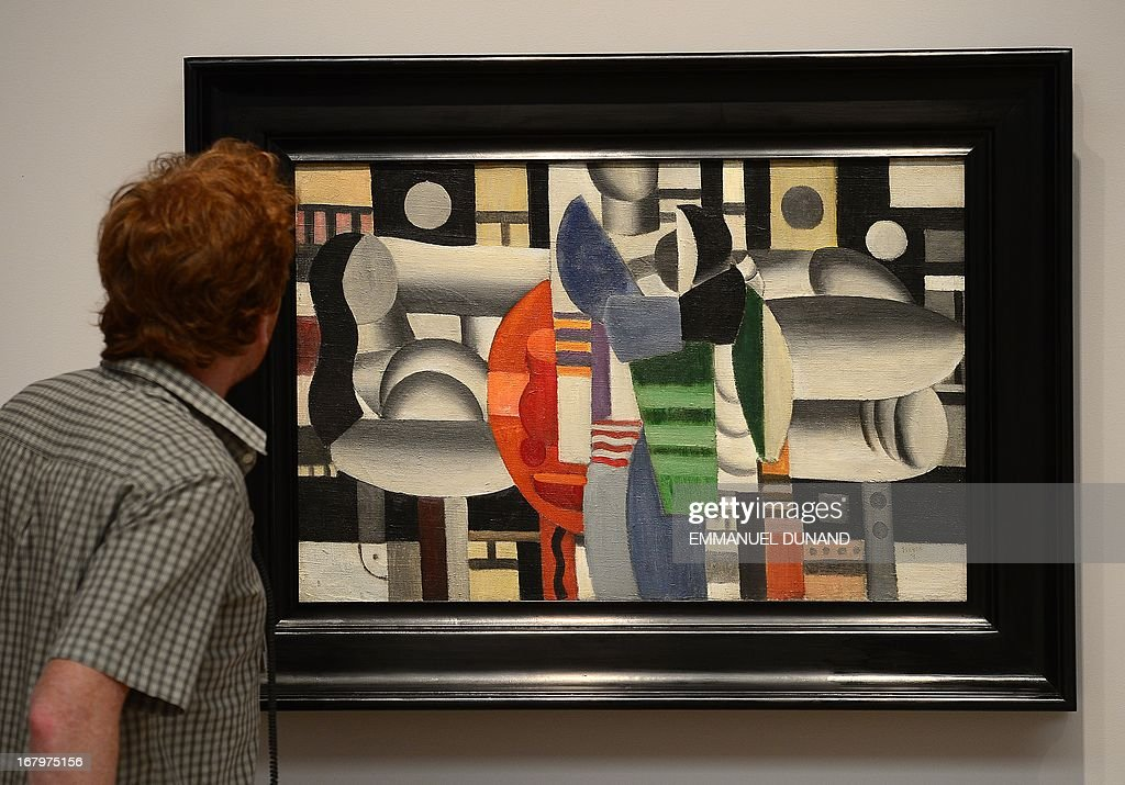 'Trois femmes a la table rouge' by Fernand Leger, a painting owned by US singer Madonna, is on display during a preview of Sotheby's Impressionist and Modern Art sales in New York on May 3, 2013. The painting is on sale to benefit the Ray of Light Foundation, Madonna's foundation to support girls' education in Afghanistan, Pakistan and other countries. Sotheby's is scheduled to hold its Impressionist and Modern Art sales May 7. AFP PHOTO/Emmanuel Dunand ++RESTRICTED TO EDITORIAL USE, MANDATORY MENTION OF THE ARTIST UPON PUBLICATION, TO ILLUSTRATE THE EVENT AS SPECIFIED IN THE CAPTION++