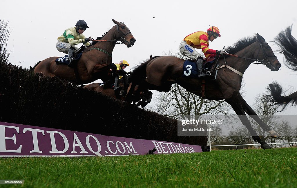 Trojan Sun ridden by Felix de Giles (3) jumps the ditch to win the Connoll's Red Mills Racehores Cubes Handicap Steeple Chase at Huntingdon Racecourse on January 11, 2013 in Huntingdon, England.