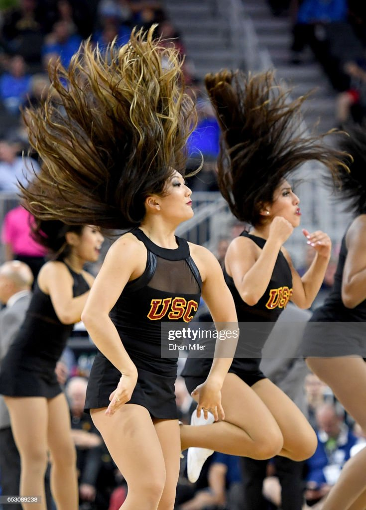 Trojans cheerleaders perform during the team's quarterfinal game of the Pac-12 Basketball Tournament against the UCLA Bruins at T-Mobile Arena on March 9, 2017 in Las Vegas, Nevada. UCLA won 76-74.