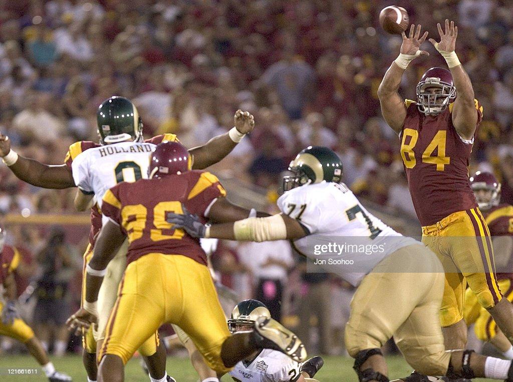 USC Trojans defensive lineman Shaun Cody deflects pass of Colorado State Rams quarterback Justin Holland in the third quarter Saturday September 11...