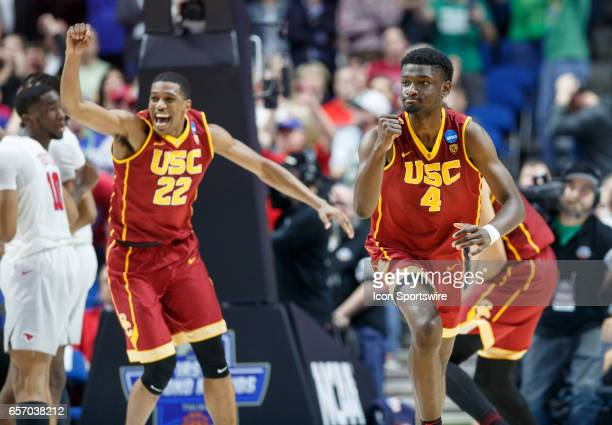 Trojans forward Chimezi Metu and guard De'Anthony Melton celebrate as time expires during the NCAA Tournament first round game game between the SMU...