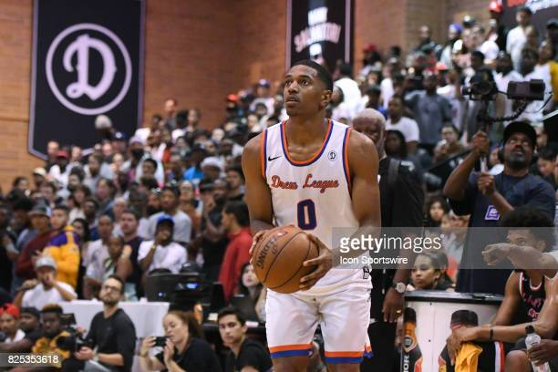 Trojans guard De'Anthony Melton attempts a three point shot during a Drew League game at King Drew Magnet High School on July 30th 2017
