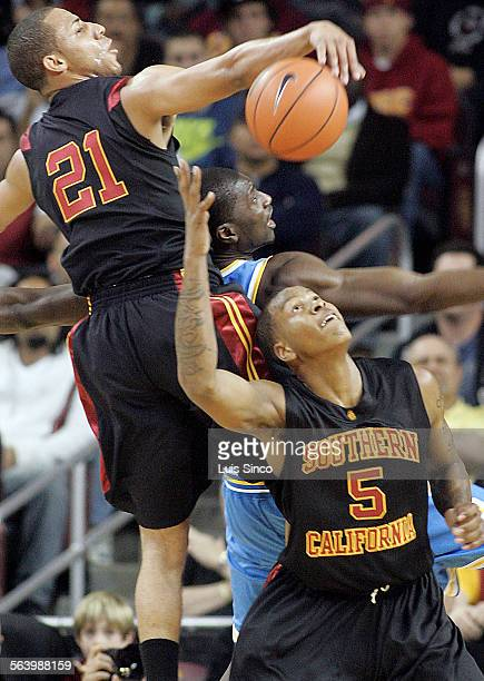 USC Trojans guard Dwight Lewis left and teammate Davon Jefferson rip the ball away from UCLA Bruins forward Luc Richard Mbah A Moute in the the first...