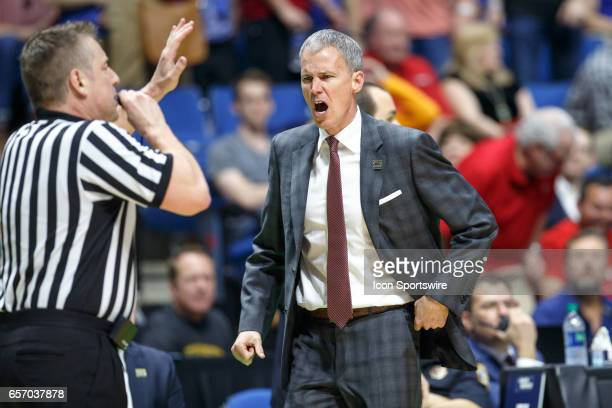 Trojans head coach Andy Enfield complains to the referee about a call during the NCAA Tournament first round game game between the SMU Mustangs and...