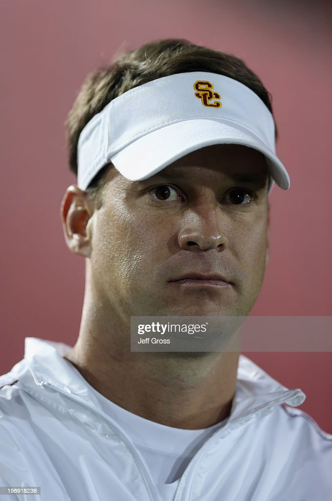 Trojans head coach <a gi-track='captionPersonalityLinkClicked' href=/galleries/search?phrase=Lane+Kiffin&family=editorial&specificpeople=4120527 ng-click='$event.stopPropagation()'>Lane Kiffin</a> looks on prior to the start of the game against the Notre Dame Fighting Irish at Los Angeles Memorial Coliseum on November 24, 2012 in Los Angeles, California. Notre Dame defeated USC Trojans 22-13.
