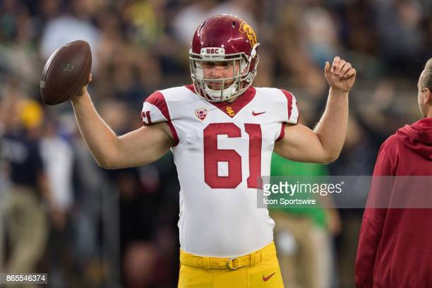 Trojans long snapper Jake Olson warms up before the college football game between the Notre Dame Fighting Irish and USC Trojans on October 21 at...