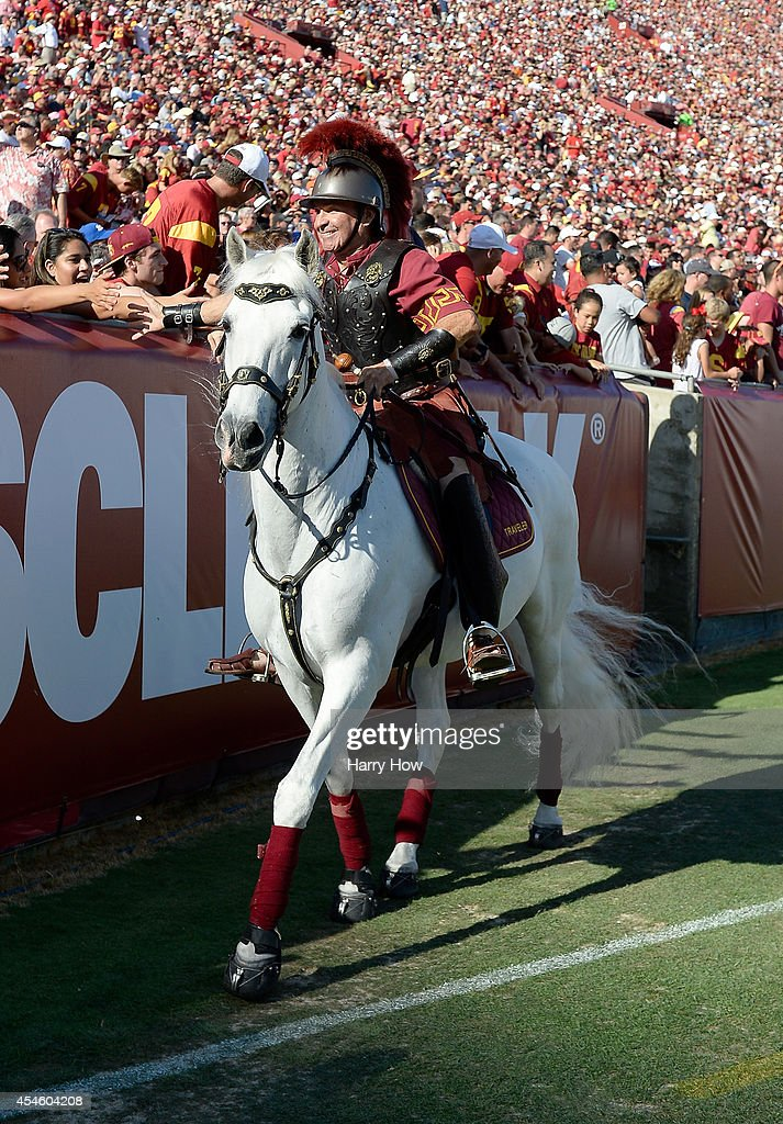 Trojans mascot celebrates a touchdown with fans during the game between the Fresno State Bulldogs and the USC Trojans at Los Angeles Memorial Coliseum on August 30, 2014 in Los Angeles, California.