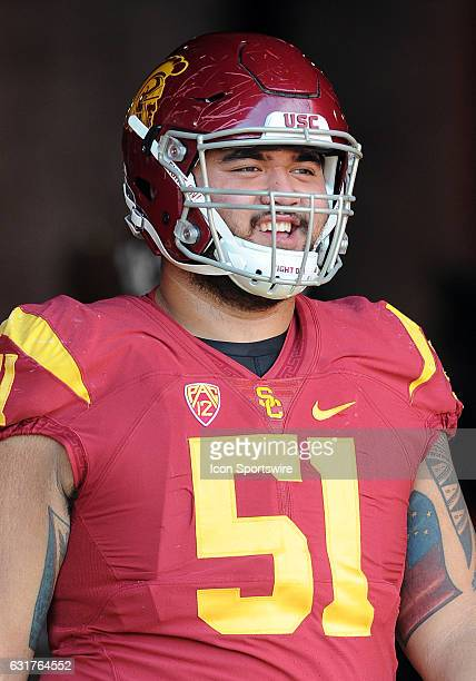 Trojans offensive guard Damien Mama heads for the field before the start of a game against the Notre Dame Fighting Irish on November 26 played at the...